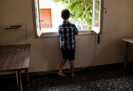Mohamed Barri, looks out of the window of the apartment he shares with his mother, siblings and grandparents while they wait to be reunited with Mohamed's father in Germany. The Barri family received a visit from the UN High Commissioner for Refugees Filippo Grandi at the apartment in Athens they are staying in under Greece's refugee accommodation programme. One family member was killed when their house and bakery business were bombed and they decided to flee Aleppo in February 2016 when another family member was kidnapped. Half of the family will be relocated to France and the others to Germany.