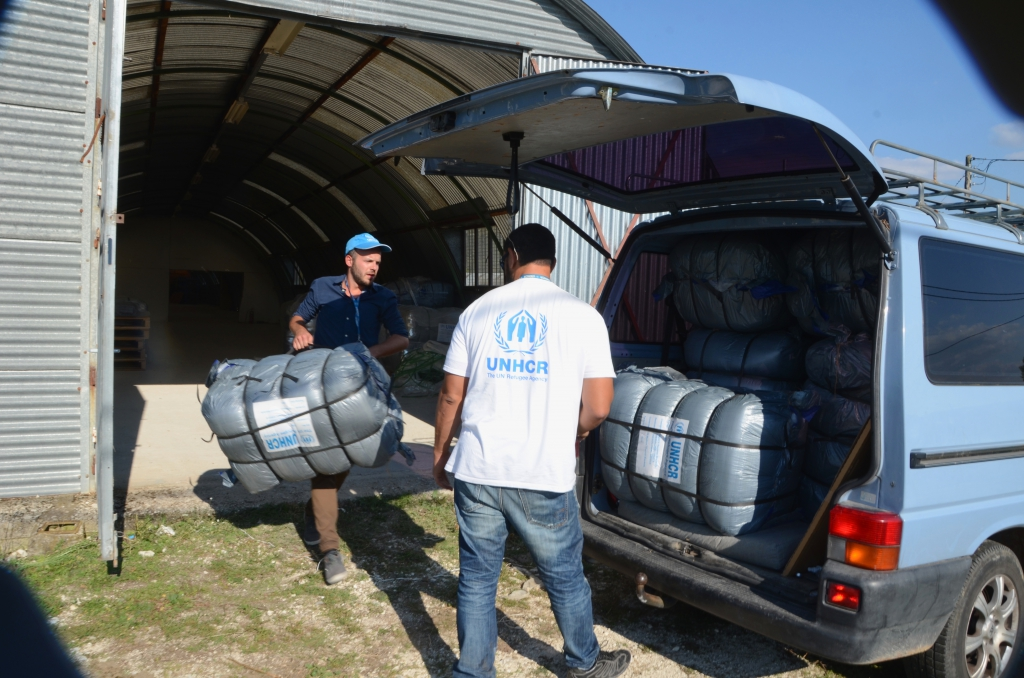 UNHCR staff Claas Morgenstern (left) and Mohamed Othman preparing thermal blankets in UNHCR warehouse in Western Greece as part of preparations for winter. There are approximately 361 tent shelters and 15 administrative buildings. In this are area of about 31,281 square meters and with the possibility of increasing in size as more refugees may be relocated here as nearby camps are reaching capacity.